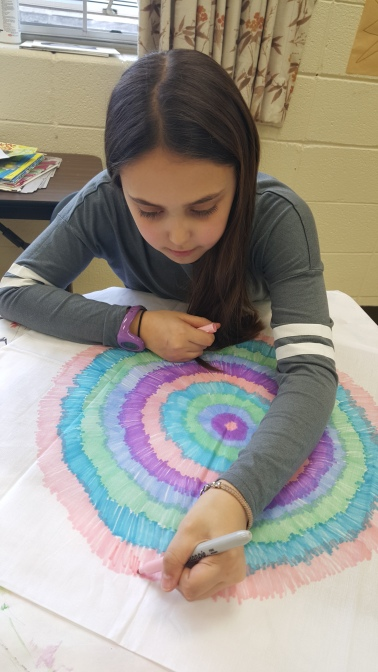 Phoebe creating an awesome star burst design